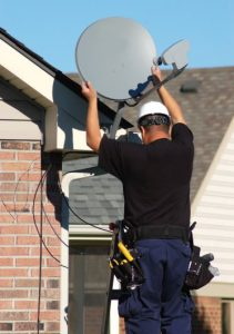 tech installing satellite dish