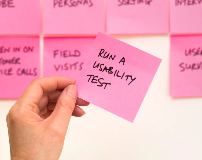 "Sticky note with ""run a usability test"" written on it"